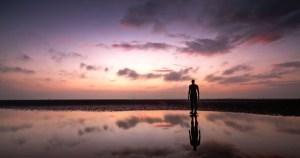 man-on-beach-sunrise